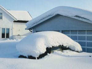 Snowed in house and car