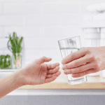 hand giving a purified distilled water